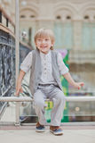 Little boy walking in big supermarket Royalty Free Stock Photography