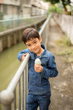 Little boy walking and eating ice cream Royalty Free Stock Photo