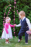 Little boy walking with girl in the summer park Stock Image