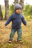 Little boy walking during the hiking activities in forest. Photo Royalty Free Stock Images