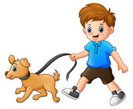Little boy walking with his dog Royalty Free Stock Images