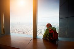 Little boy walking on a observation deck. Little boy walking on a roof of a skyscrapper Royalty Free Stock Photo