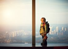 Little boy walking on a observation deck. Little boy walking on a roof of a skyscrapper Royalty Free Stock Images
