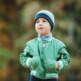 Little boy walking in the park Royalty Free Stock Image