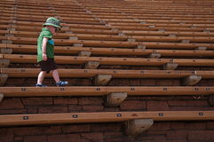 Little Boy Walking at Red Rocks Amphitheater stock photo