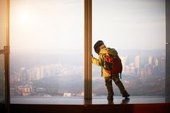 Little boy walking on a observation deck. Little boy walking on a roof of a skyscrapper Royalty Free Stock Image