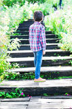 Little boy walking on Stairs going uphill Stock Image
