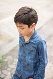 Little boy walking on the street jean fashion Royalty Free Stock Photography