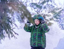 Little boy during walking in winter forest portrait Royalty Free Stock Photography