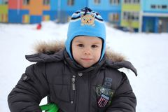 Little boy walking in winter in the snow happy smiling royalty free stock images