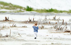 The little boy walks in the desert place. Royalty Free Stock Photos