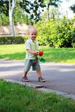 A little boy walks in the park Royalty Free Stock Images