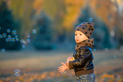 Little boy walks with soap bubbles Royalty Free Stock Image