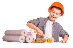 Little boy with wallpaper and paint roller Royalty Free Stock Photos