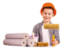 Little boy with wallpaper and paint roller Stock Image