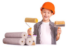 Little boy with wallpaper and paint roller Royalty Free Stock Photo