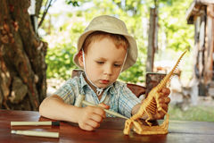 Little boy wants to be an archaeologist royalty free stock photography
