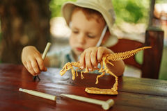 Little boy wants to be an archaeologist. Cute little boy wants to be an archaeologist stock photo