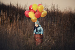 Little boy wants to fly on balloons Royalty Free Stock Photo