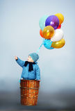 Little boy wants to fly on balloons Royalty Free Stock Images