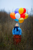 Little boy wants to fly on balloons Royalty Free Stock Photos