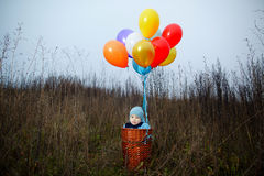 Little boy wants to fly on balloons Royalty Free Stock Image