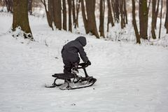 Boy and snow racer in winter Royalty Free Stock Photos