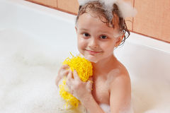 Little boy with a washcloth bathes in bathroom Royalty Free Stock Photography
