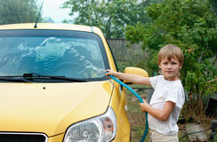 Little boy washing car Stock Photography