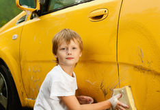 Little boy washing car Stock Images