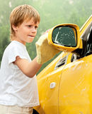 Little boy washing car. Stock Photography
