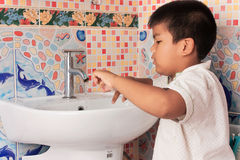 Little Boy washing hand  in the wash room Royalty Free Stock Image