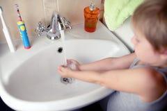 Little boy washing hand in washbasin Stock Image