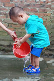 Little boy washing his feet Royalty Free Stock Photography