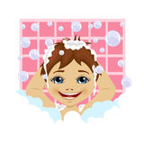 Little boy washing his hair with soap foam and bubbles in bathroom Stock Photo
