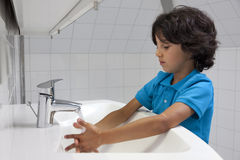 Little boy washing his hands Stock Image