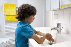 Little boy washing his hands Stock Images