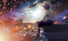Little boy watching the end of the world Royalty Free Stock Images