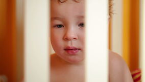 Little boy watching a film sitting in the playpen. Closeup. stock video footage