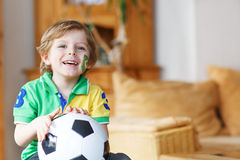Little boy watching football cup game on tv. Royalty Free Stock Photography