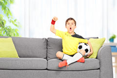 Little boy watching a football match at home Royalty Free Stock Photos
