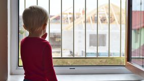Little boy is watching how a new house is built Royalty Free Stock Image