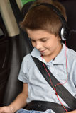 Little boy watching movie on tablet in the car Royalty Free Stock Photography
