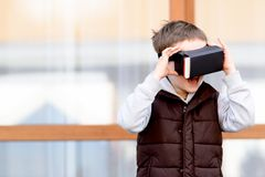 Little boy watching movie in VR virtual reality goggles Royalty Free Stock Images