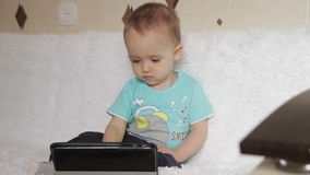 Little boy watching a movie on your tablet and stock video footage
