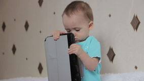 Little boy watching a movie on your tablet and stock footage