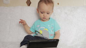 Little boy watching a movie on your tablet and stock video