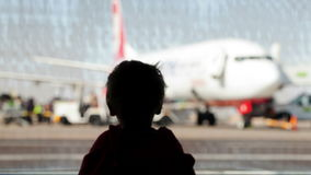 Little boy watching planes at the airport Royalty Free Stock Photography