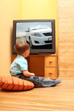 Little boy watching TV. Little boy watching cinema on TV. TV screen - photo of the author royalty free stock images