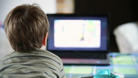 Little boy watching TV,backside view, stock footage Royalty Free Stock Photography
